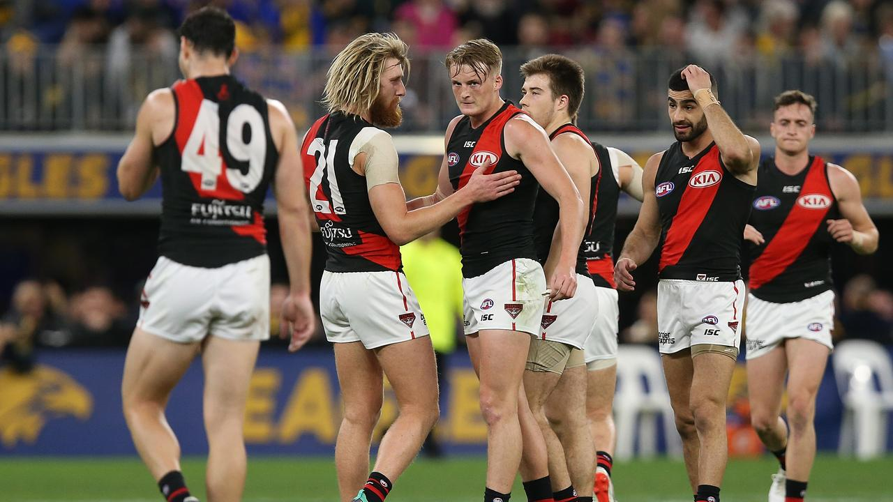 Dyson Heppell with Conor McKenna. Picture: Paul Kane/Getty Images