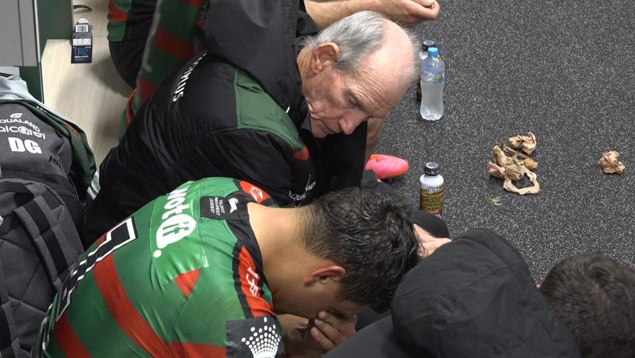 Latrell Mitchell receives support from Bunnies teammates and coach Wayne Bennett