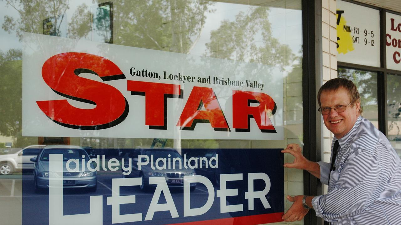 Star general manager Bruce Horrocks puts the finishing touches on the Laidley Plainland Leader banner in 2011.
