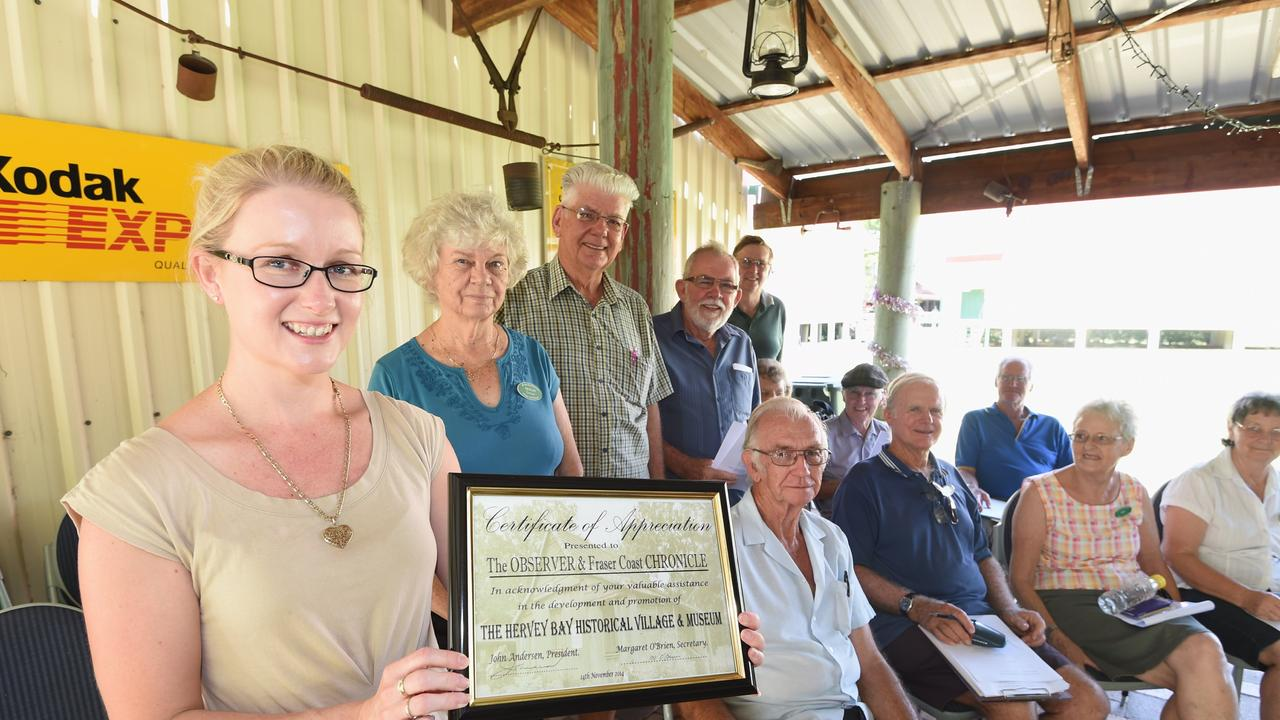 Editor Kerrie Alexander with a certificate of appreciation from the Hervey Bay Historical Village and Museum.