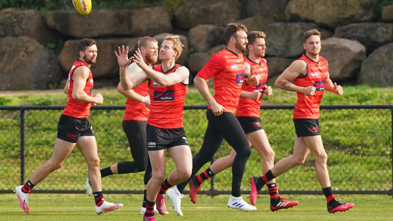 Conor McKenna, Michael Hurley, Cale Hooker, Matt Guelfi train during an AFL Essendon Bombers training session.