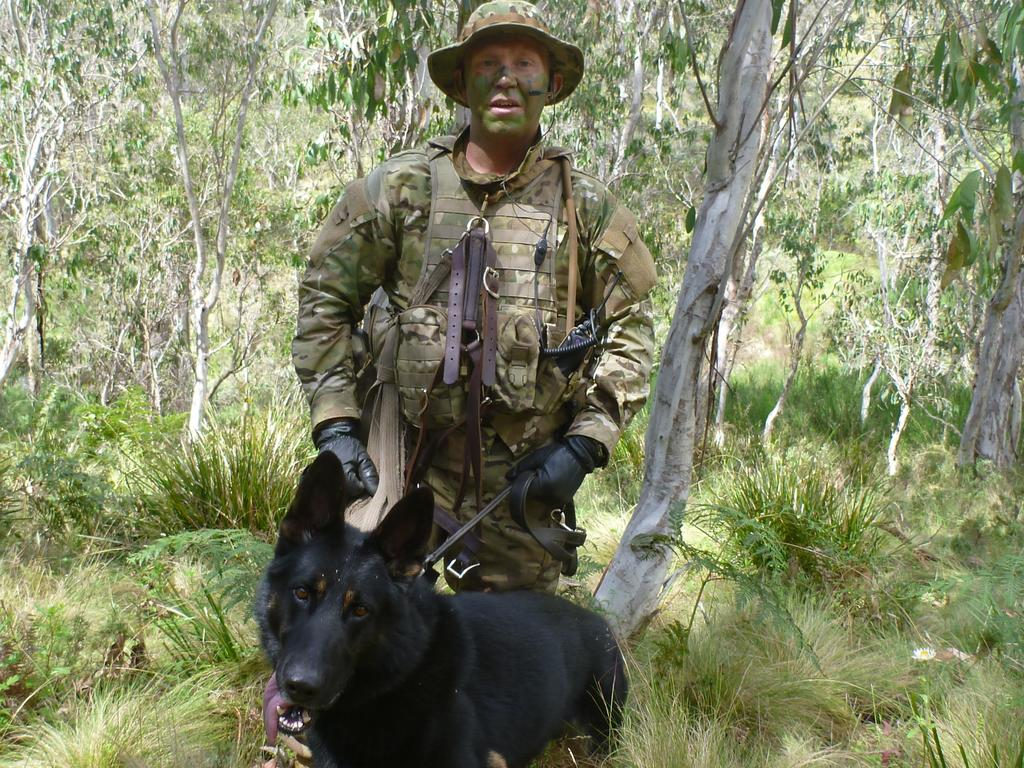 Luke Warburton and his dog Chuck on the hunt for Malcolm Naden. Picture: Supplied