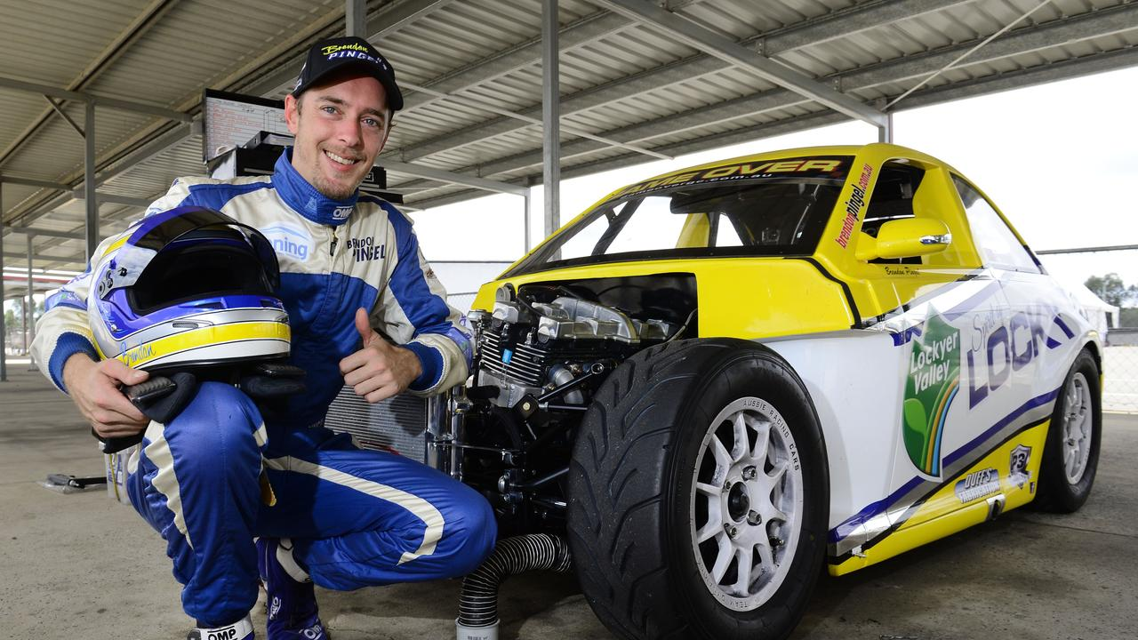 Aussie Racing Car driver Brendon Pingel with his 5/8 scale purpose-built racing car that had to be rebuilt following a spectacular crash at Queensland Raceway.