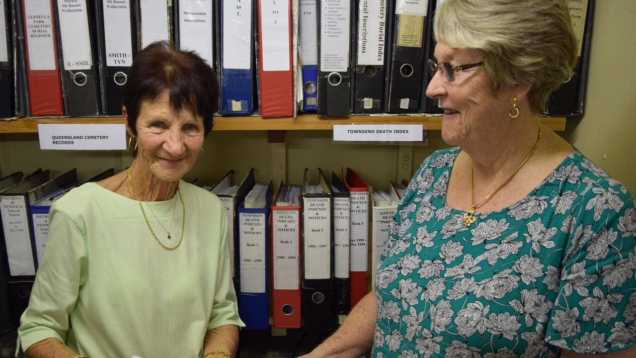 Bev Pyman and Mackay Family History Association treasurer Yvonne Peberdy look over the records compiled for 31 years by Doreen Townson. Photo: Emily Smith