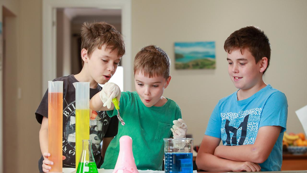 Owen, 10, Ethan, 7, Arran Storie, 12, at home doing science experiments. Picture: Justin Lloyd