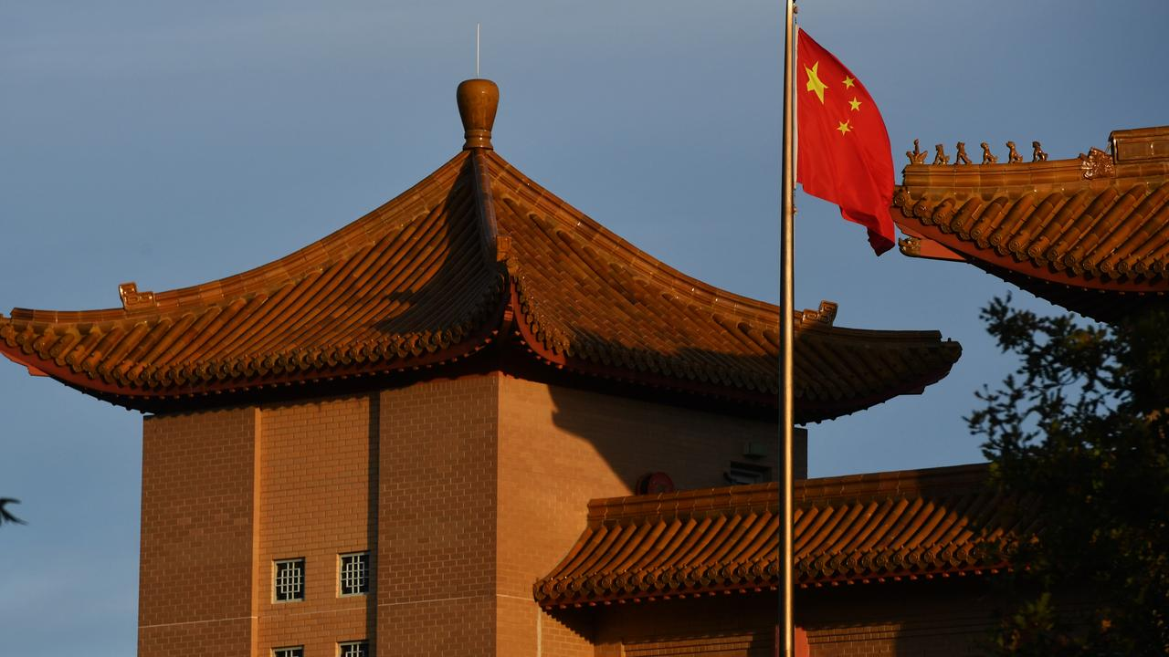 A Chinese flag flies at the Embassy of the People's Republic of China in Canberra. A new report has found Chinese foreign investment in Australia is likely three times higher than currently reported. Picture: Sam Mooy/Getty Images