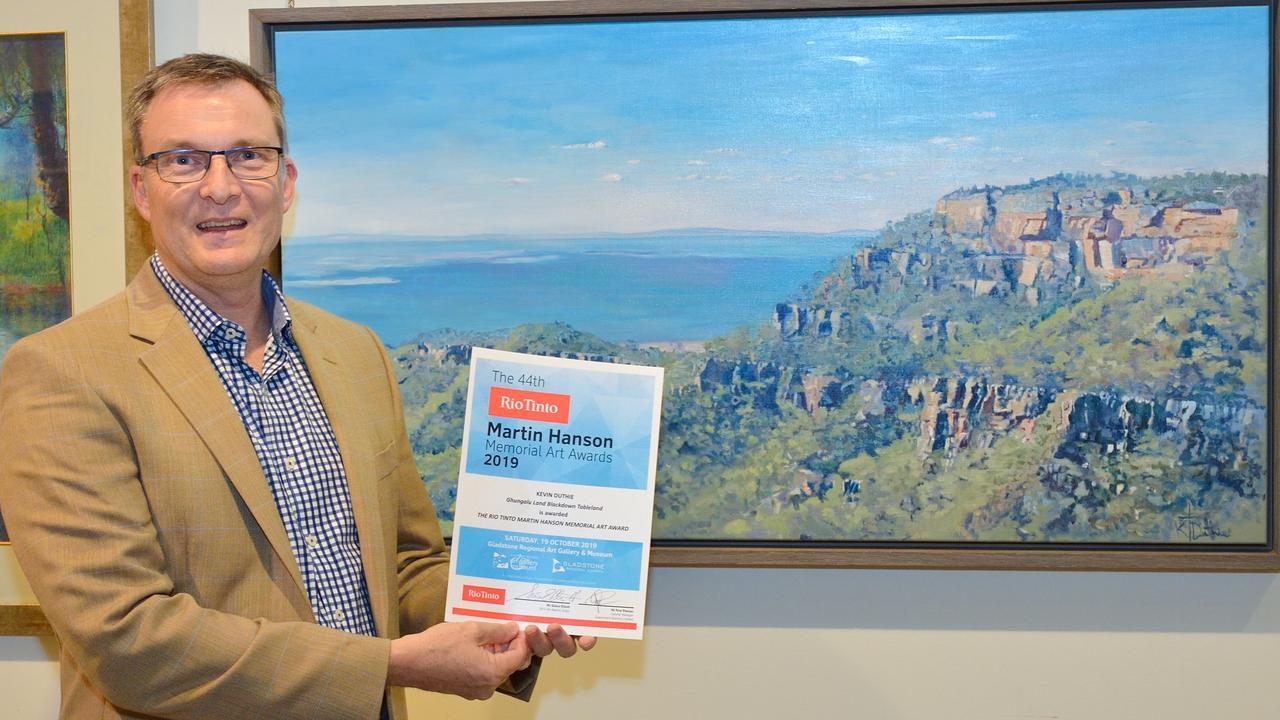2019 judge Simon Elliott with the Rio Tinto Martin Hanson Memorial Art Award winner, Ghungalu Land Blackdown Tableland by Kevin Duthie. Photo: M Richards