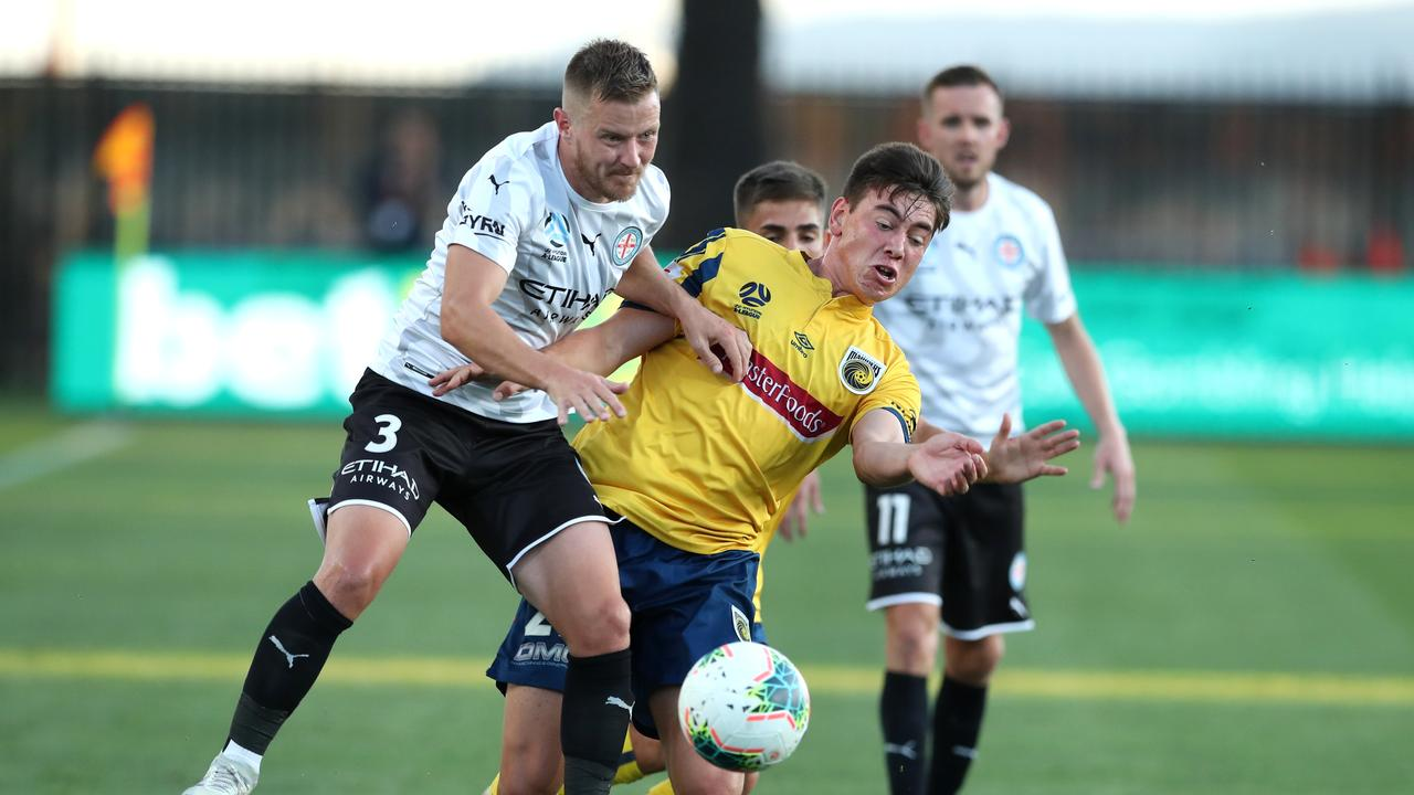 Lewis Miller of the Central Coast Mariners contests the ball with Scott Jamieson of Melbourne City during their round 24 A-League match.