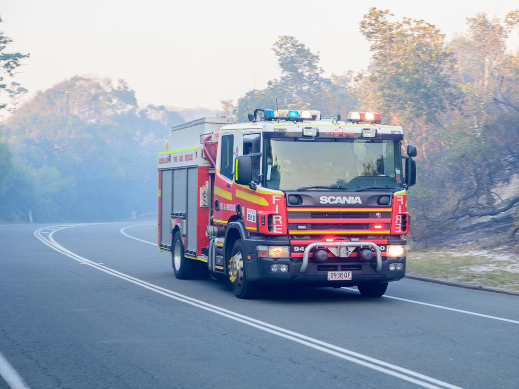 Queensland Fire and Emergency Services rush to the Peregian Beach bushfire. Picture: Wavell Bush Photography