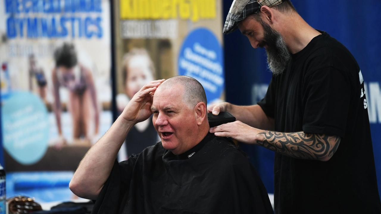 COURAGEOUS EFFORT: Superintdent Michael Sawrey gets his head shaved as part of a cancer fundraiser. Photo: Cody Fox