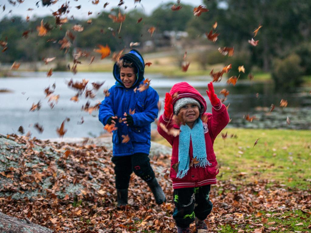 August Jones-Fama'aea, 6, and sister Olive, 3, of Springfield enjoy the cold weather in Stanthorpe. Pic Liz Fama'aea