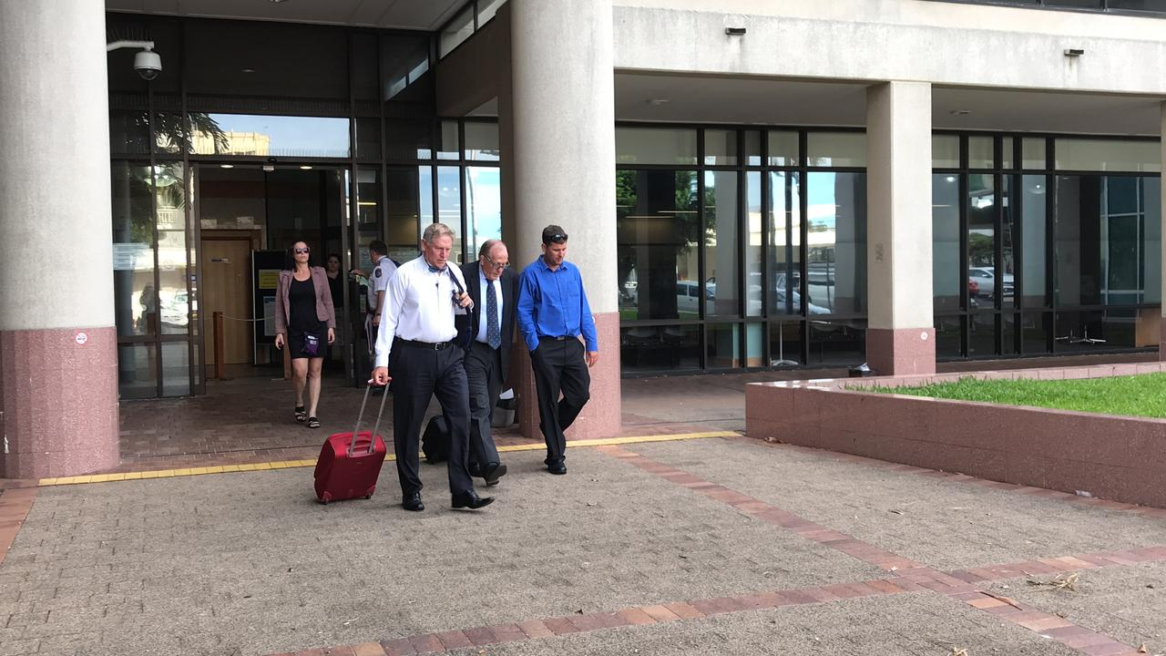 Truck driver Marc Anthony Palmer (blue shirt) walks free from the Cairns courthouse after pleading guilty to dangerous driving causing grievous bodily harm over a crash on the Bruce Hwy in 2016.