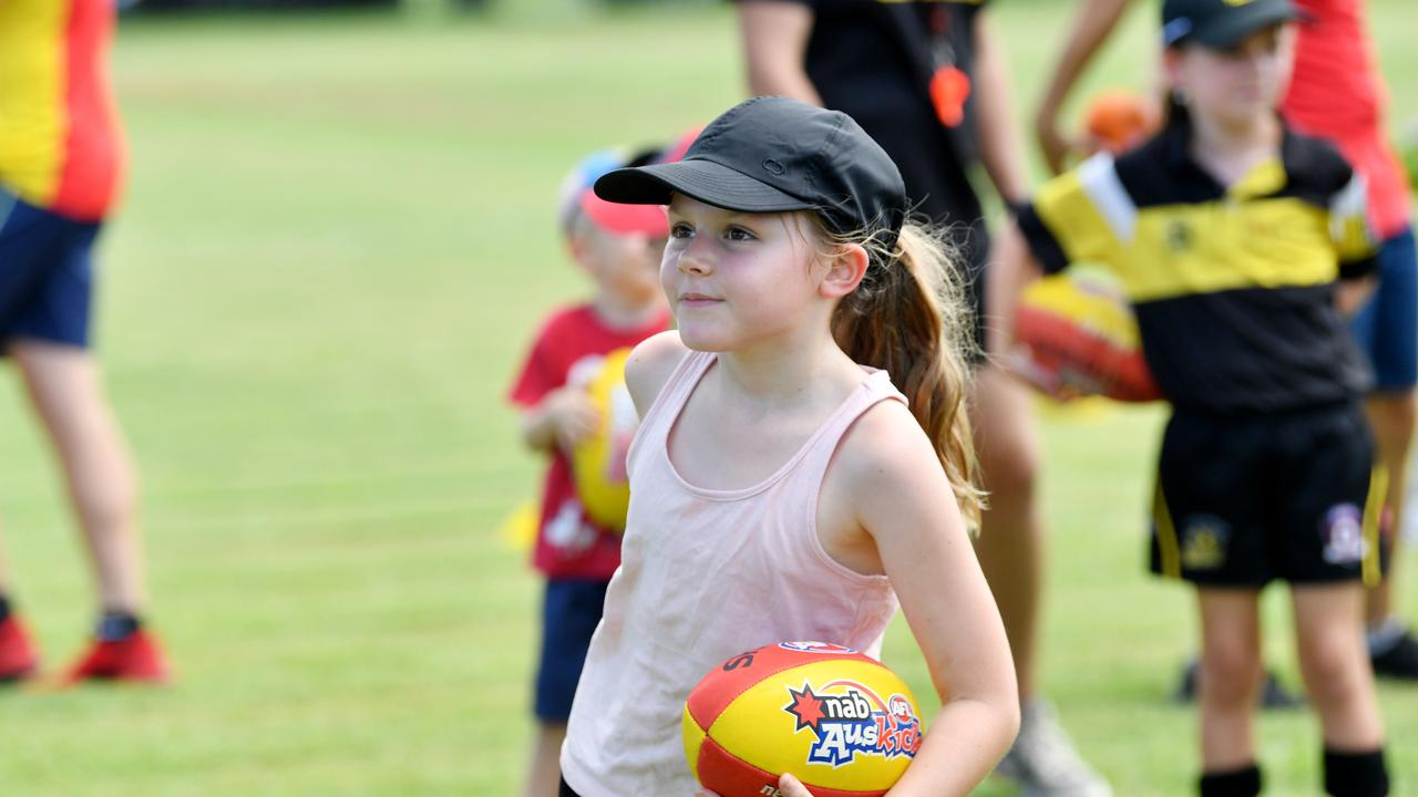 Emma Ramsland, 8, from North Mackay, holds onto the footy at the AFL come and try day. Picture: Tony Martin