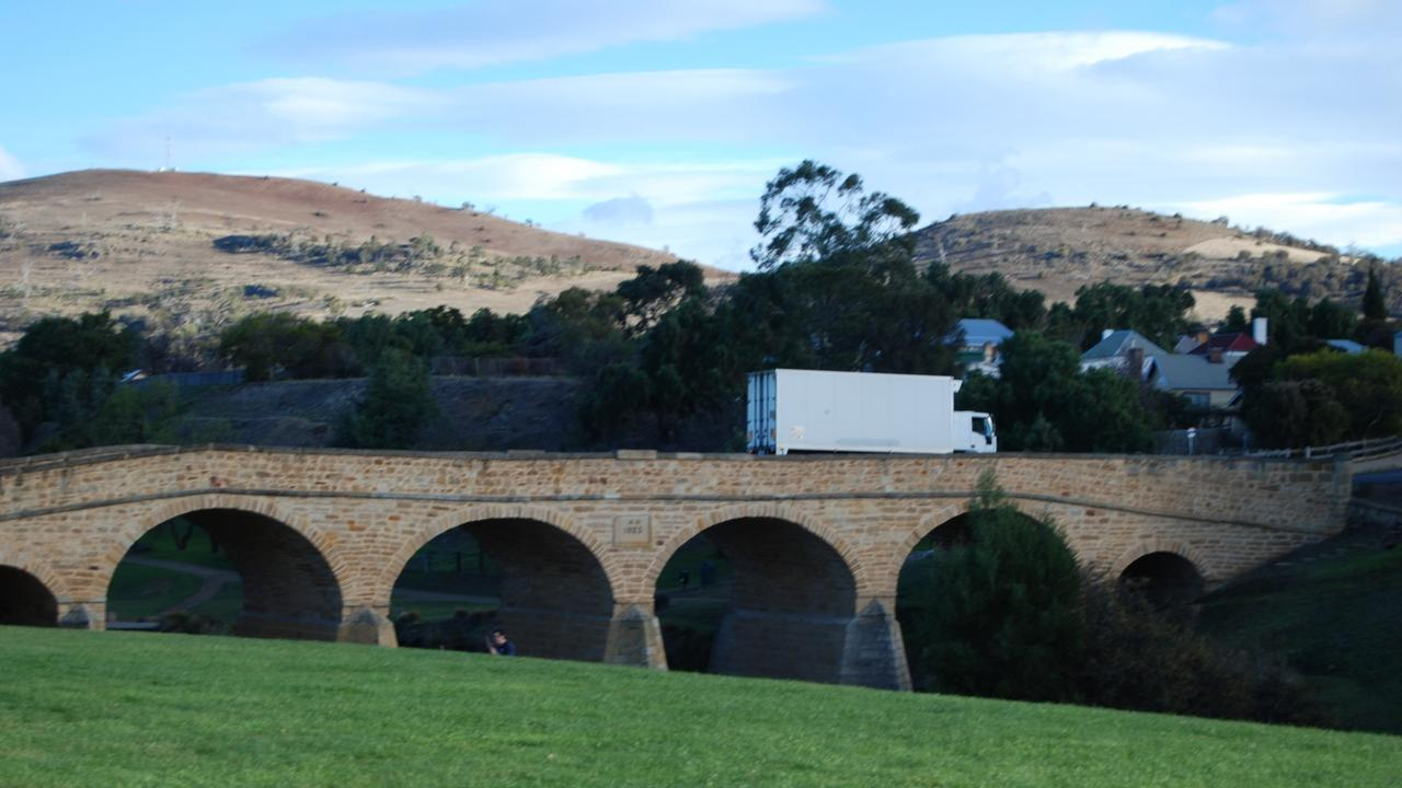 A light truck travels across Australia's oldest traffic bridge at Richmond in Tasmania.