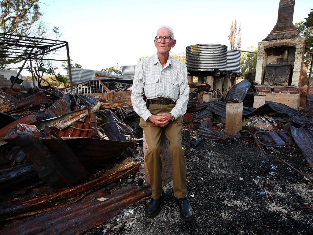 Stanthorpe resident Alain Bourzali returns to his home that was totally destroyed during the fires. (Photo: Adam Head)