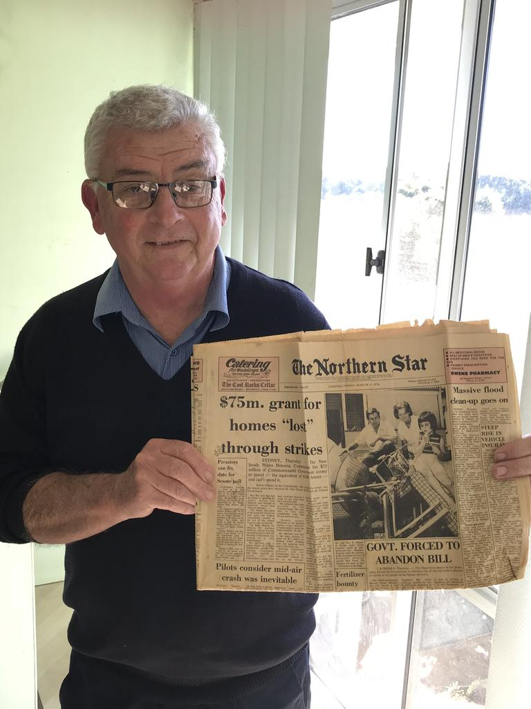 VINTAGE: Mark Sharpe with a copy of the Northern Star which showcases his family on the front page following a flood.