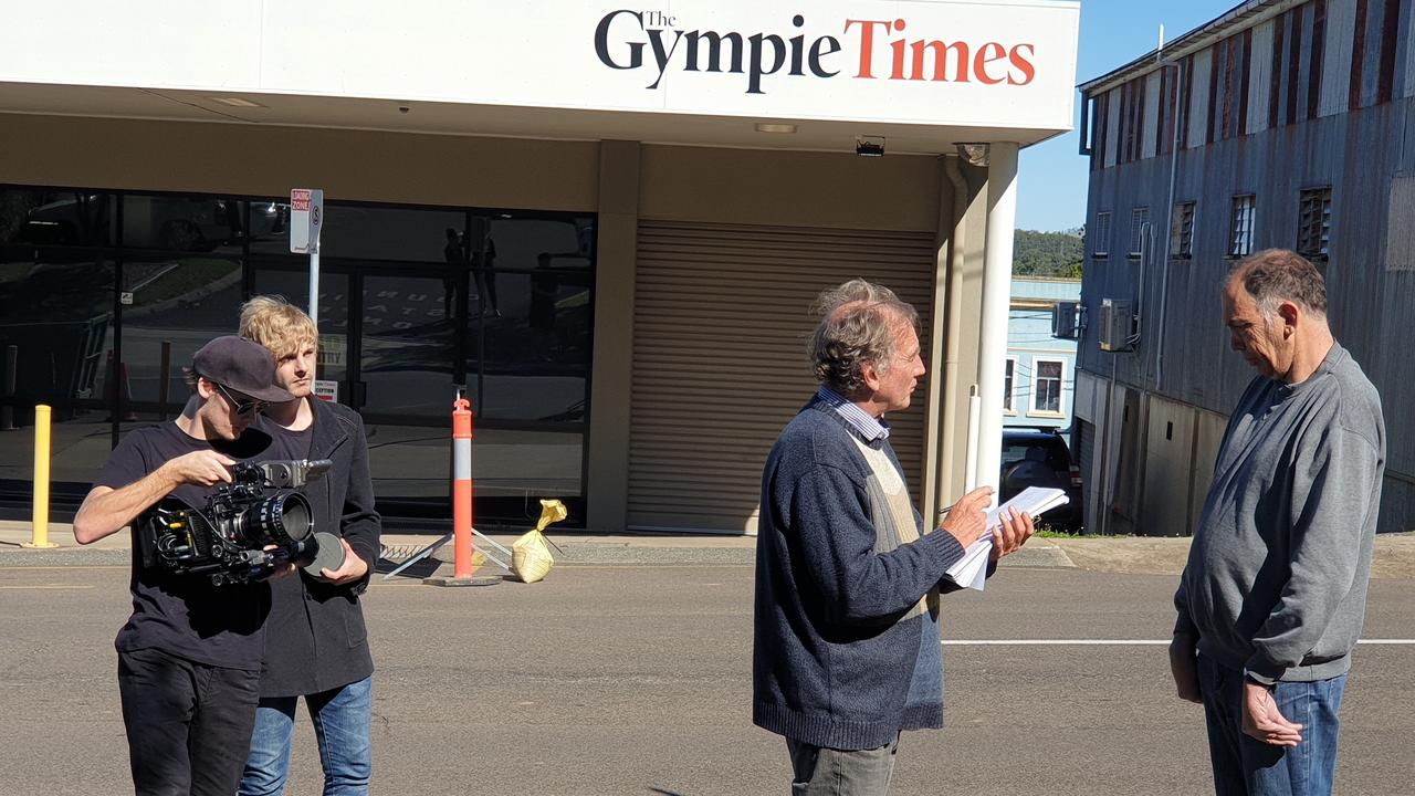 Michael Condon talks with reporter Arthur Gorrie during documentary filming outside The Gympie Times office.