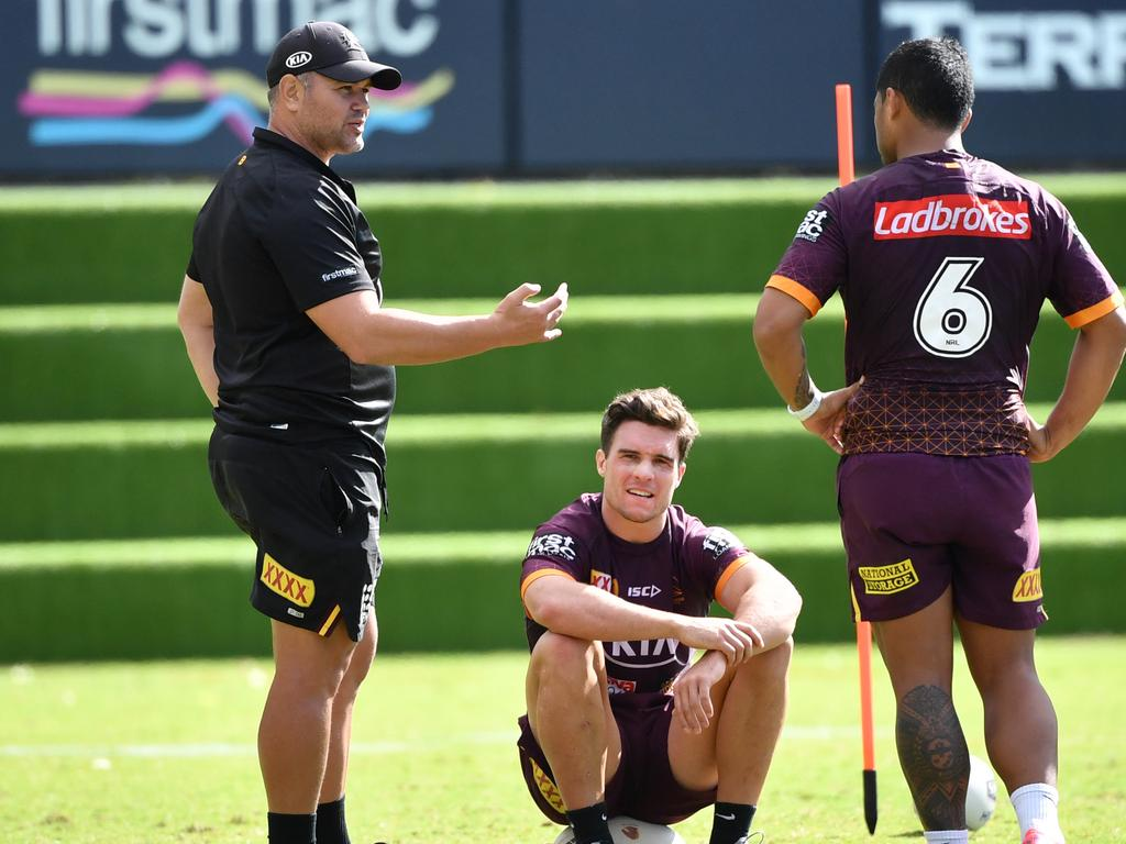 Anthony Seibold (left) talks to his struggling halves. Picture: AAP