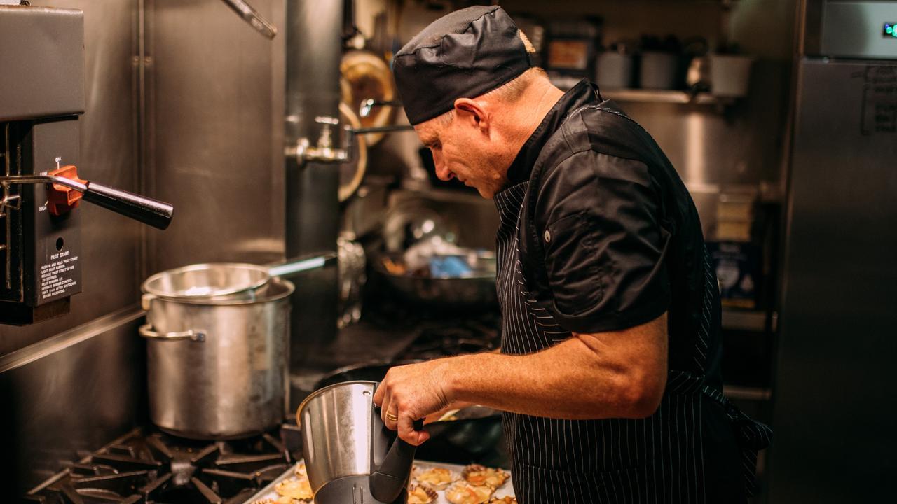 La Vida chef and owner Nick Hooper working hard in the kitchen.
