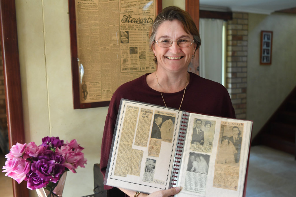 Image for sale: Andrew Tynan with her scrapbook of Morning Bulletin articles which her grandmother began in Mt Morgan