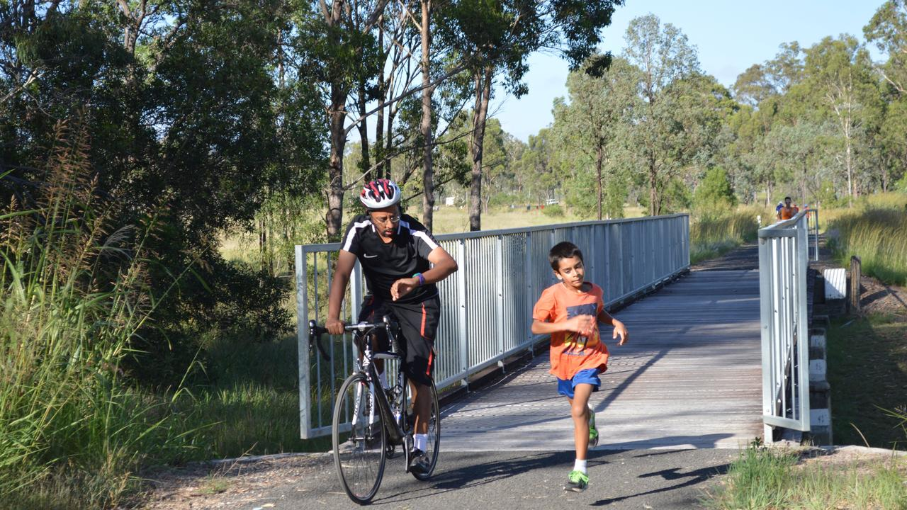 SET THE PACE: Joshua Williams being paced by his dad Jason at Wondai Parkrun's second birthday celebration. (Picture: Claudia Williams)