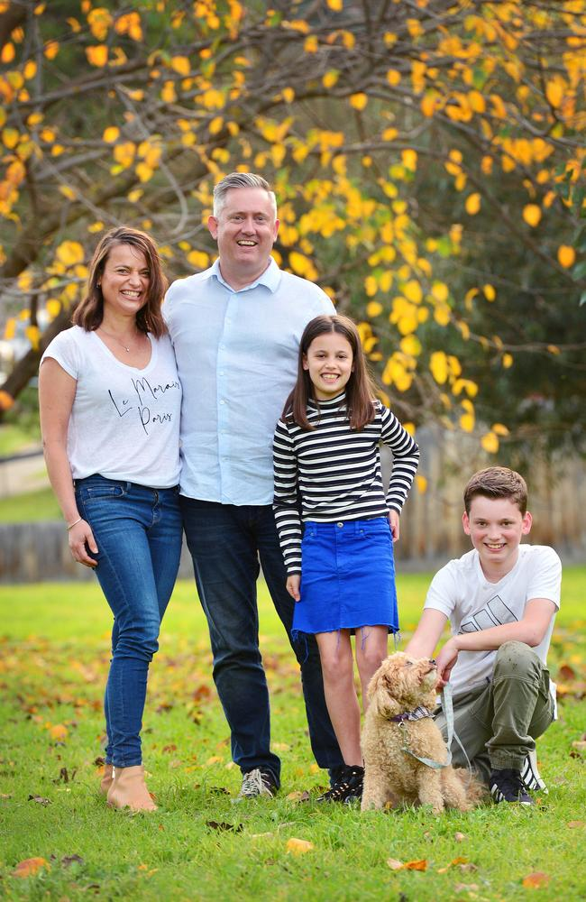 Paul and Angela Saines with Oscar, 12, and Mila, 9, and dog Maggie. Picture: Nicki Connolly