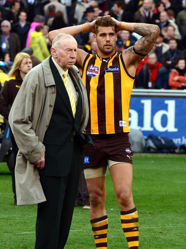 Commiserating with Lance Franklin in 2012. Picture: Wayne Ludbey