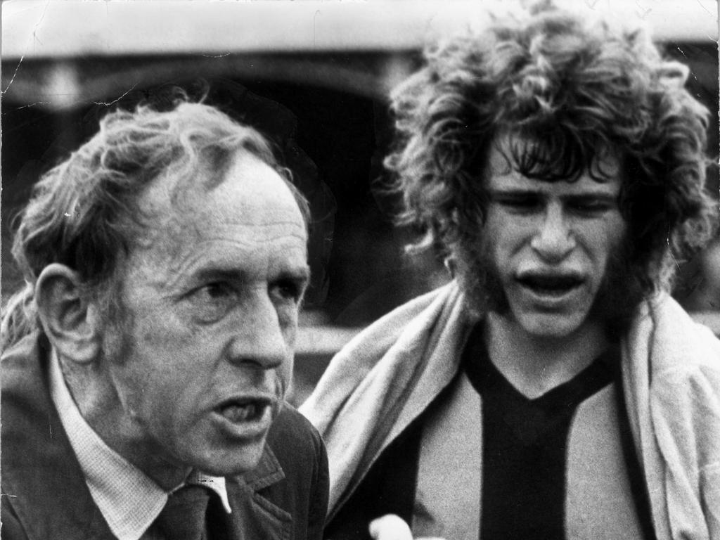 Sending a message alongside player Alan Martello in 1975.