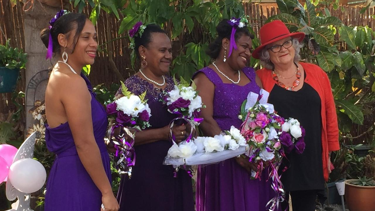 BACKYARD WEDDING: Beautiful bridesmaids Regina, Ruby and Jenny with Audrey-May Thomson. Picture: Rhylea Millar.