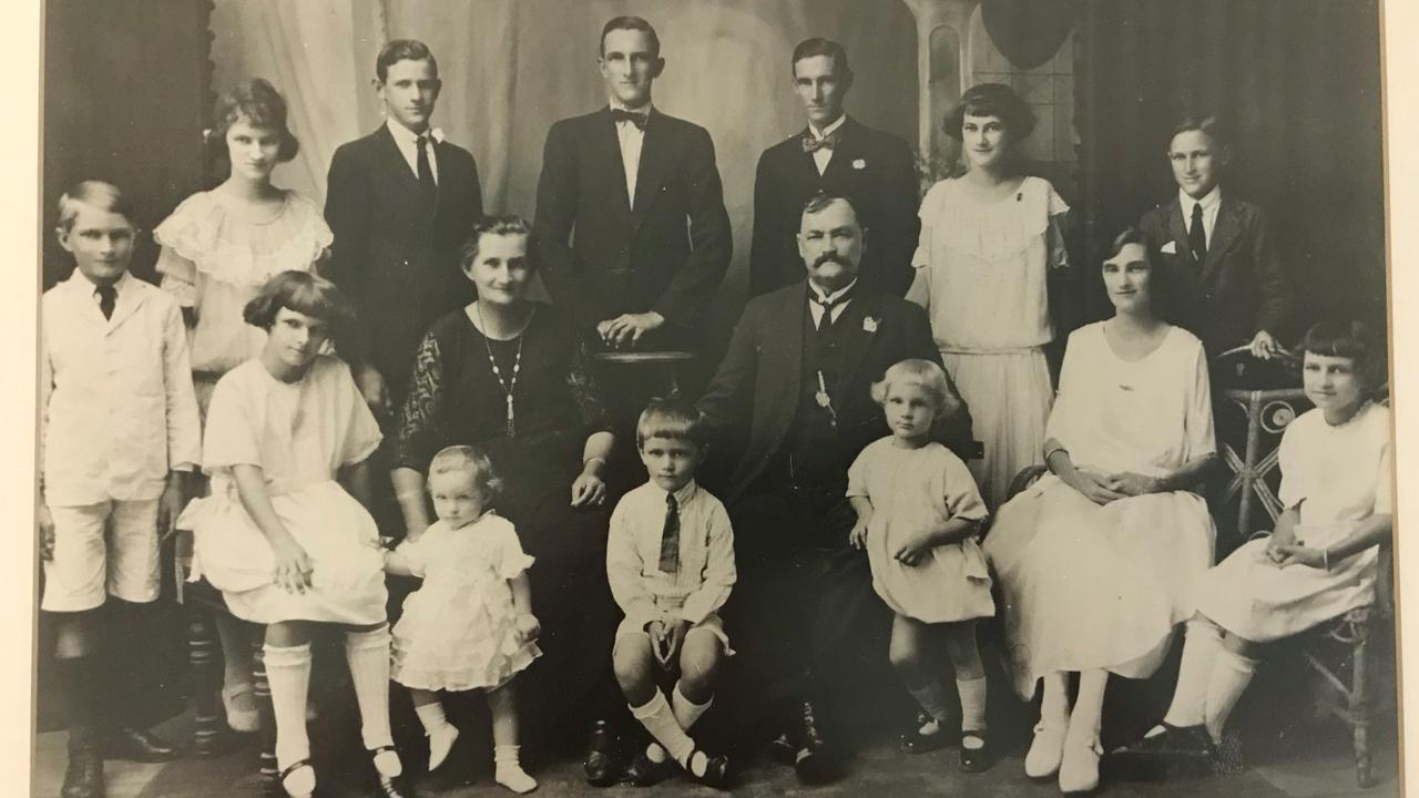 Caroline and William Henry Darwen (centre, sitting) with their children in about 1925. Pictured with them are (standing, from left) Henry, Madge, Jim, Ron, Victor, Mabel, Claude, (sitting, from left) Marjorie, Enid, Roy, Bob, Doris and Irene.
