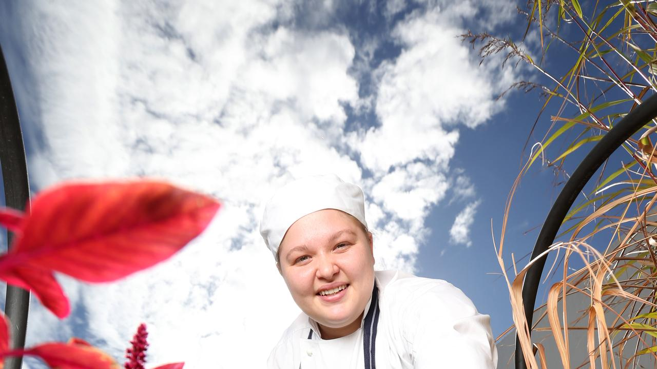 Ellie Priest, apprentice chef on the rooftop herb garden at the Novotel Hotel. Photo Steve Pohlner