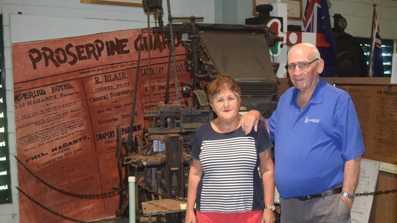 Peter and Cynthia Lewis with an old linotype machine.