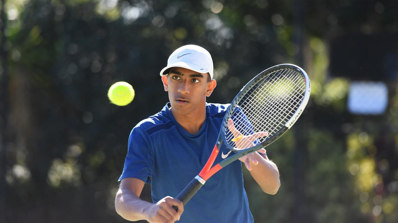 Tennis player Kanika Jayathilake watches a volley closely onto his racquet