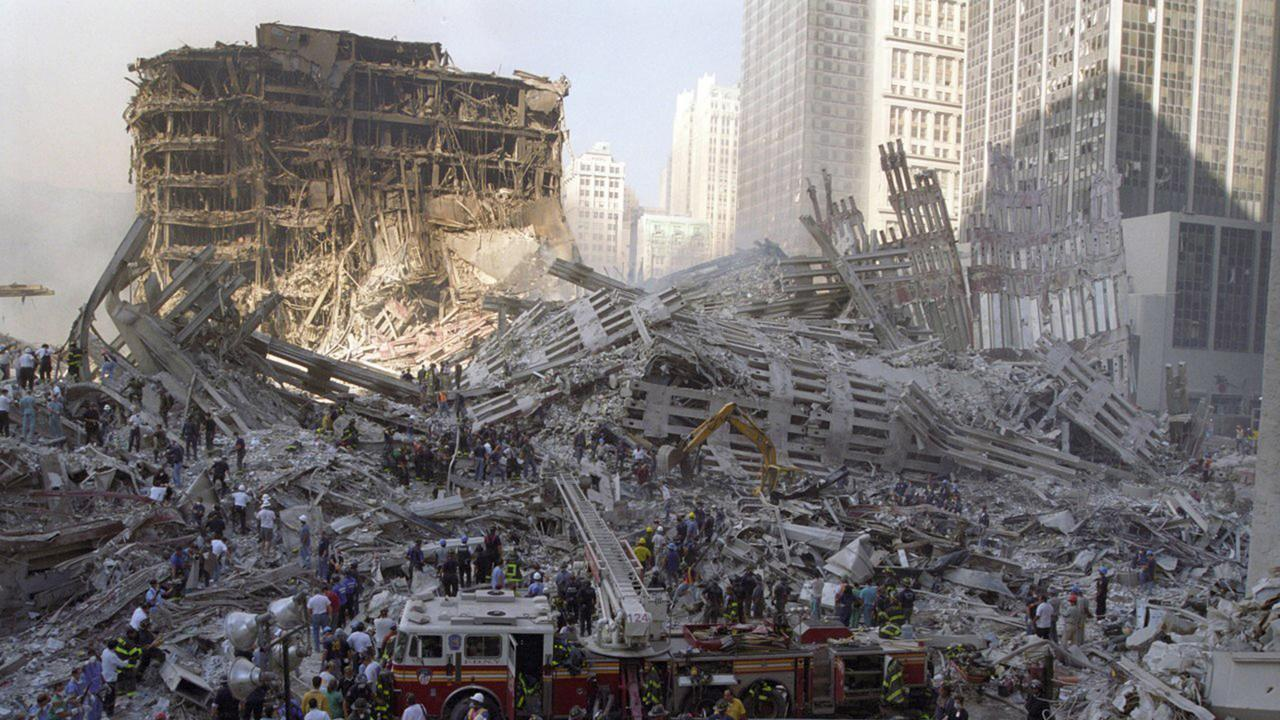 PIC FROM Dr Emil Chynn/Caters News - (PICTURED: Dr Emil Chynn's heartbreaking images of 9/11) - A physician who claims he was the first on the scene at 9/11 has released unseen photos from the day of the attack.After seeing the Twin Towers burning on September 11 2001 whilst walking his dog, Dr Emil Chynn, now 50, put on his roller blades and rushed to the scene to see what was going on.Having wo