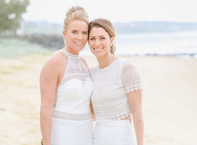 Lauren Winfield and Courtney Hill on their wedding day at Point Cartwright on the Sunshine Coast.