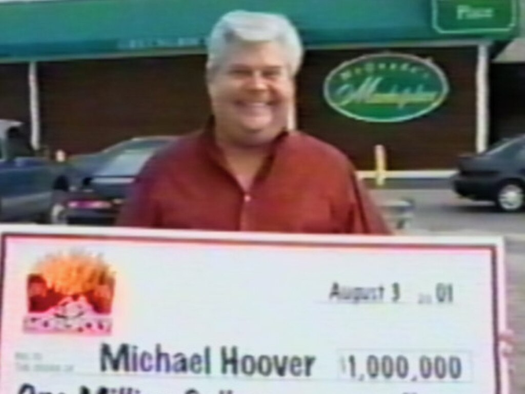 Michael Hoover with his novelty-sized cheque for $1 million.