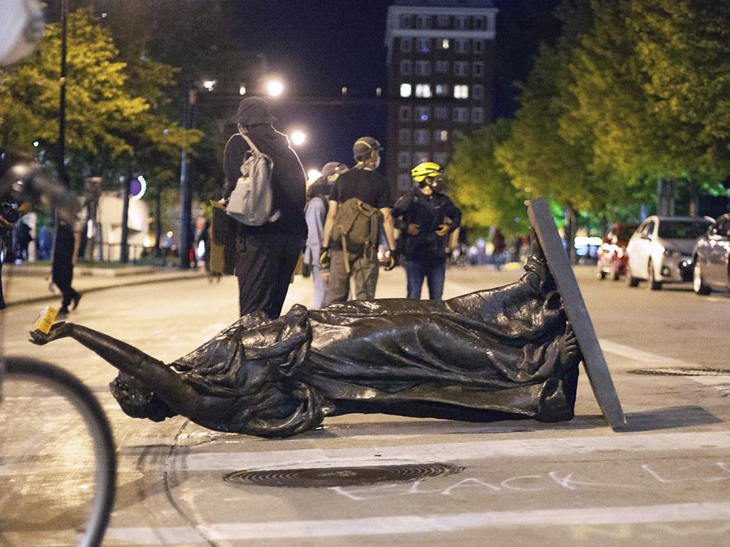 Wisconsin's Forward statue lies in the street on Capitol Square in Madison. Picture: AP