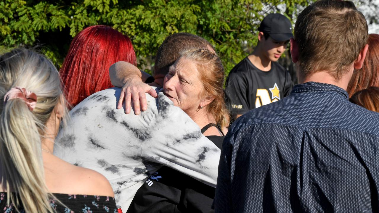 Zac Jones's mum Debbie is supported by family and friends at Loganholme as they honour the memory of her son. Picture: John Gass