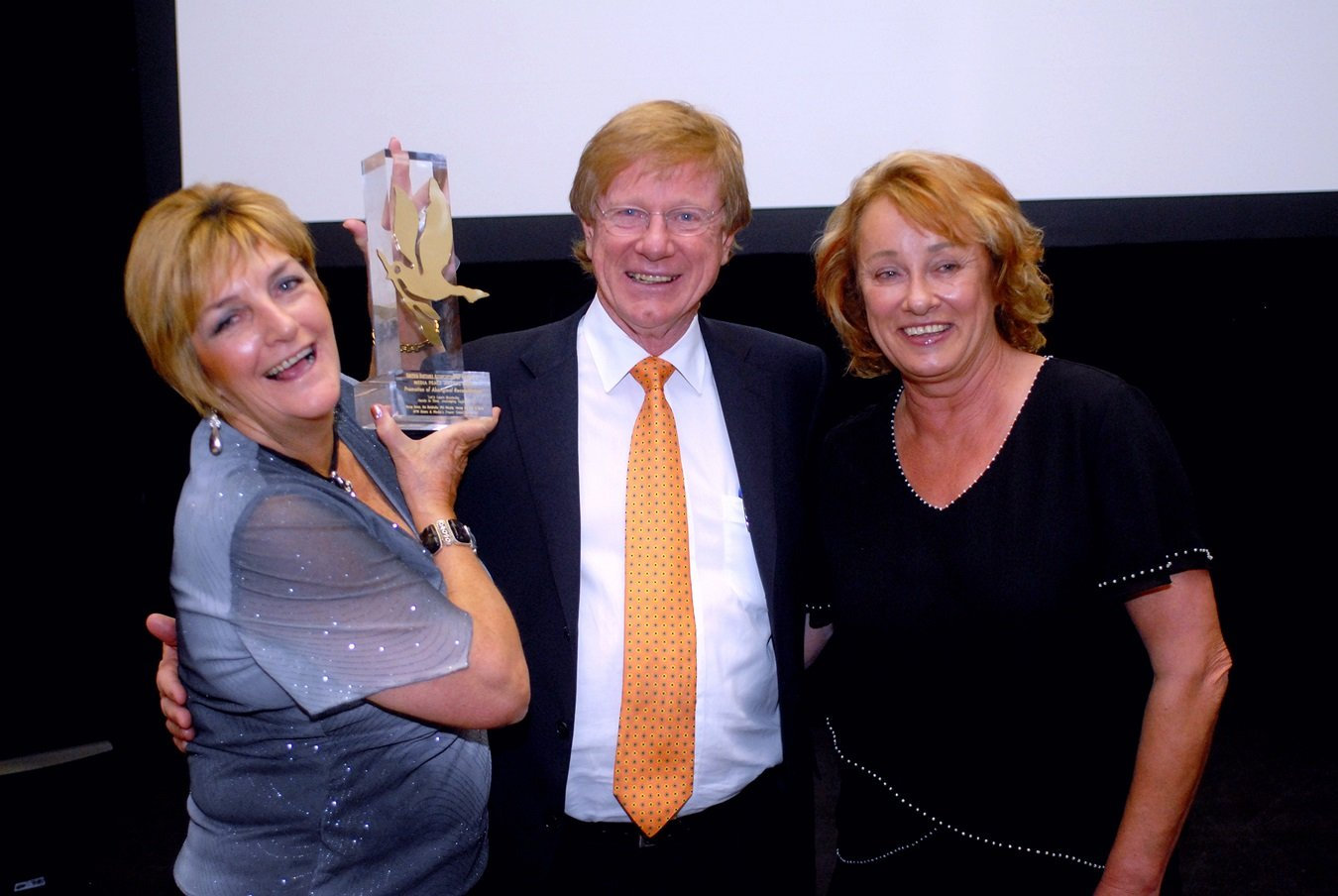 Then-Chronicle editor Nancy Bates and journalist Toni McRae receive the United Nations Promotion of Aboriginal Reconciliation award from veteran ABC journalist Kerry O'Brien. The award was given for the Chronicle's weekly series