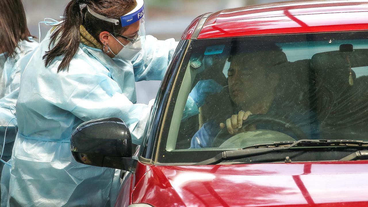 A nurse takes a sample from a motorist at Keilor Community Hub. Picture: Ian Currie