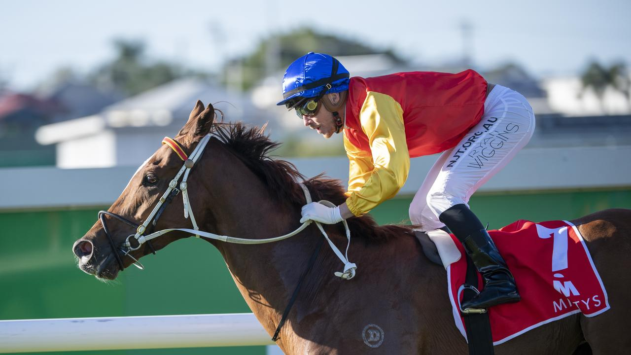 Jockey Ryan Wiggins rides Inquiry to victory in race 7, the Mittys Spear Chief Handicap, during Doomben Race Day at Doomben Racecourse in Brisbane, Saturday, June 27, 2020. (AAP Image/Supplied by Michael McInally, Racing Queensland)