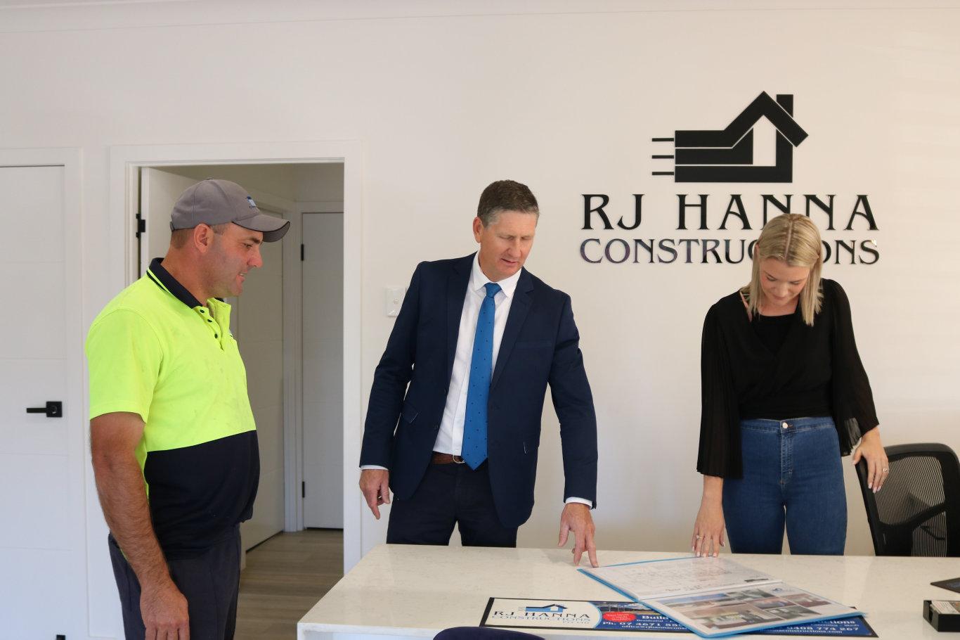 Robby Hanna and Lisa Hanna from RJ Hanna Constructions meet with mayor Lawrence Springborg (middle).