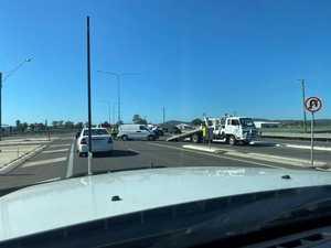 Liquid spills onto busy highway during car crash