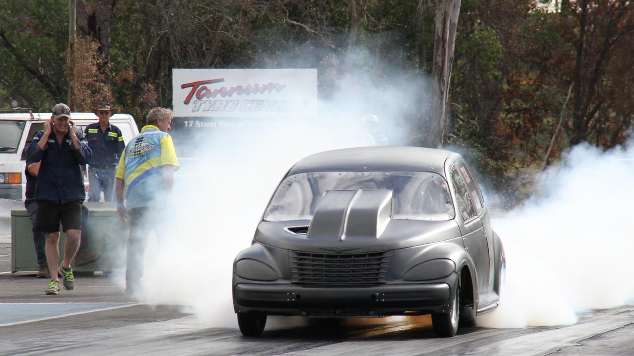 Jordan Wex heating up the tyres for maximum traction before launching his Ford 6 cylinder turbo powered Dodge PT Cruiser down the strip at Benaraby Dragway's Come and Try Day on June 27.