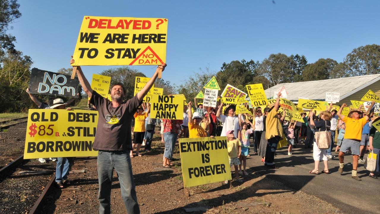 TRAVESTY: Publisher of the 'Love Mary' book Glenbo Craig protests at Kandanga at the apparent green light the government has given to the Traveston dam project. Photo: John McCutcheon.
