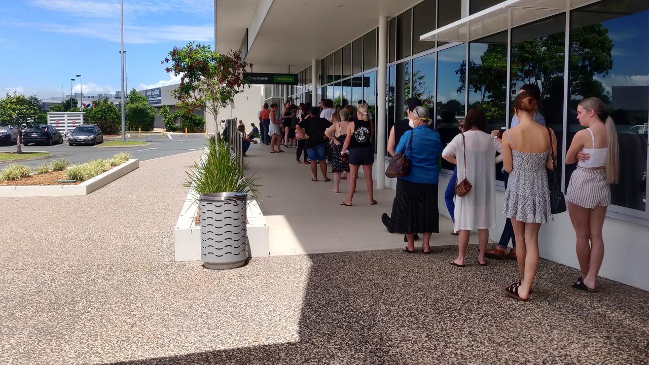 Residents line-up at Centrelink Mackay during coronavirus crisis.