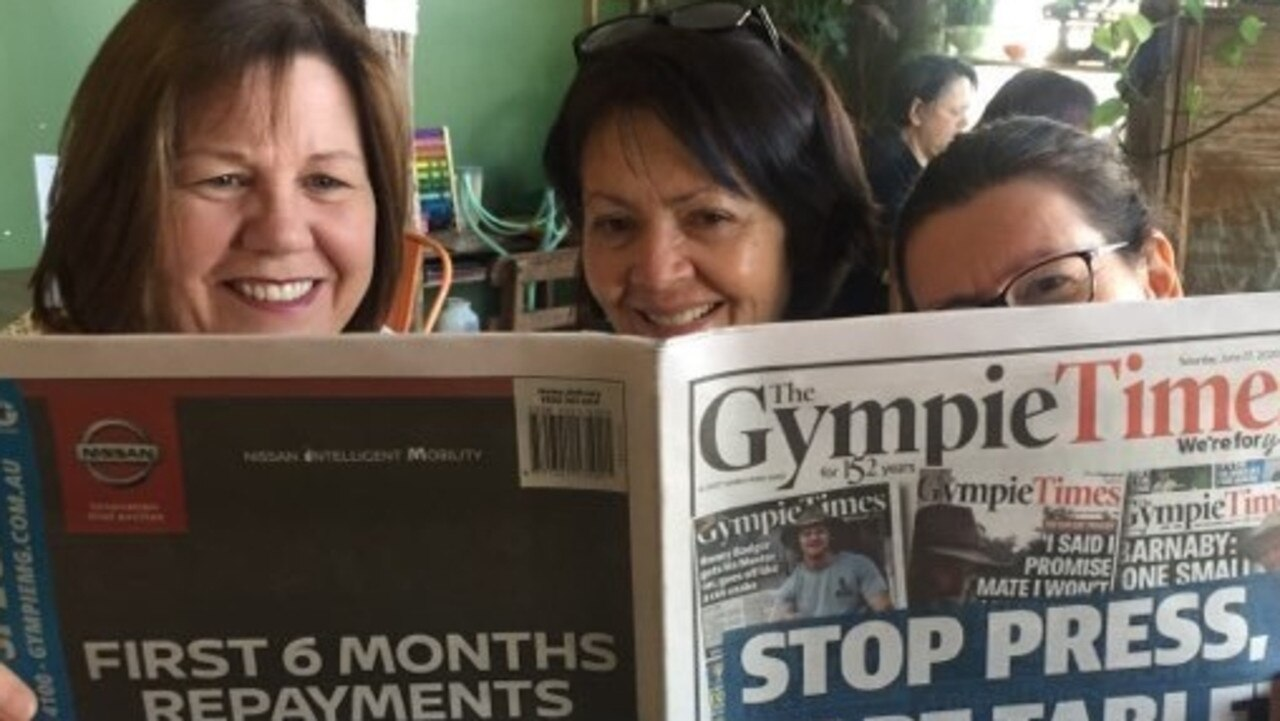 Maria Townsend-Webb, Debbie Fredman and Jo Dargusch-Haig read the final edition of The Gympie Times print at Farmer and Sun on Saturday morning.
