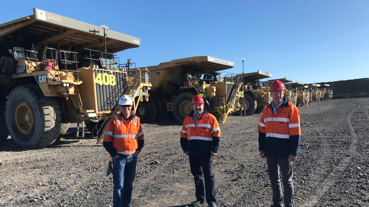 Shadow Minister for State Development, Andrew Powell MP (centre) with Acland Mine Manager Simon Ponder (left) and Condamine MP Pat Weir, pictured in front of trucks that have been parked up following the redundancies of 150 workers at New Acland last October.
