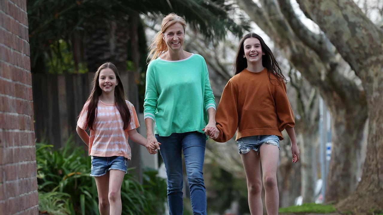 Single mother Susie Jevtovic and her two daughters. The family is watching their spending closely. Picture: Michael Klein