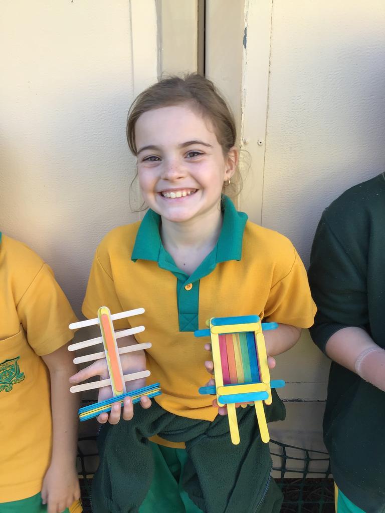 Westlawn student Bayley shows off her STEM challenge.